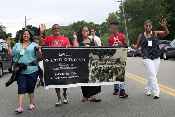 HADLEY GREEN/Staff photo<br /> People wave during a short parade at the Salem Willows Black Picnic. 7/15/17