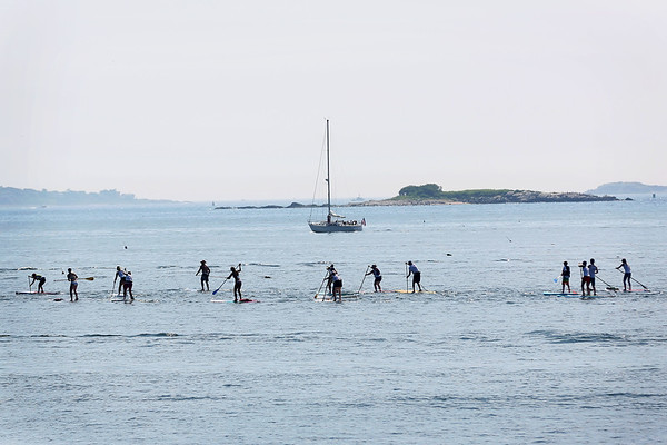 HADLEY GREEN/ Staff photo<br /> Paddlers make their way through a race course in Salem Harbor off Winter Island. 7/08/17