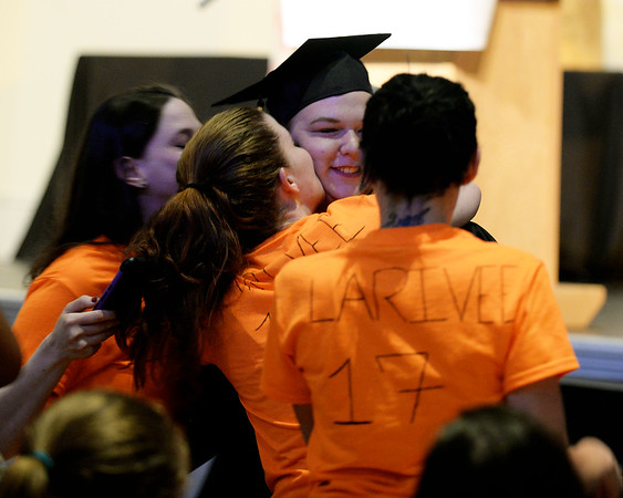 """RYAN HUTTON/ Staff photo<br /> New Liberty Innovation School graduate Heather Larivee receives hugs and kisses from friends wearing home-made """"Team Heather"""" shirts after getting her diploma at the school's graduation ceremony at the Salem YMCA's Ames Hall on Thursday"""