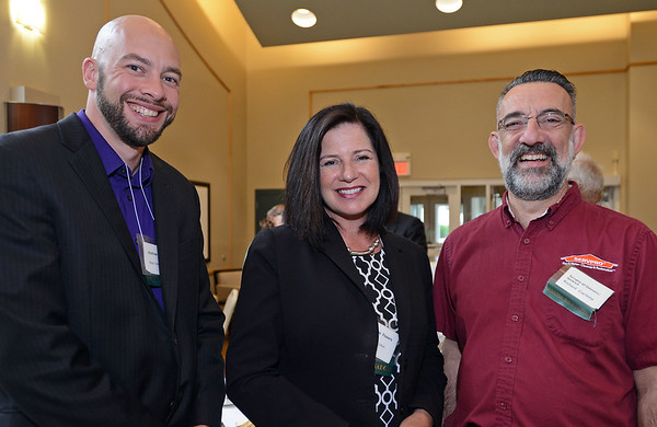 RYAN HUTTON/ Staff photo<br /> From left, Andrew Patton and LeeAnne Powers, of Align Credit Union, and Richard Ciarletta from Servpro, at the North Shore Chamber of Commerce's After Hours event at the Wylie Inn and Conference Center on Thursday.