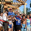 RYAN HUTTON/ Staff photo<br /> Surrounded by neighborhood kids, Salem Mayor Kim Driscoll cuts the ribbon on the freshly renovated Mary Jane Lee Park in the Point in Salem on Wednesday.