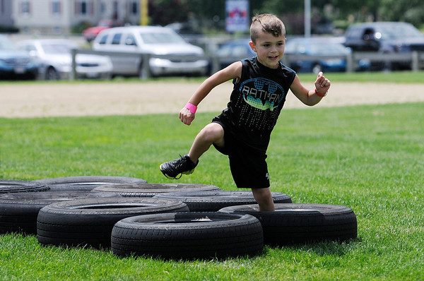 TIM JEAN/Staff photo<br /> Anthony Brogna, 5, of Danvers, runs through the tires in the obstacle course area during the 3rd Annual Field Day and Scoop-Ah-Bowl party and Family Festival at Plains Park in Danvers. 7/1/17