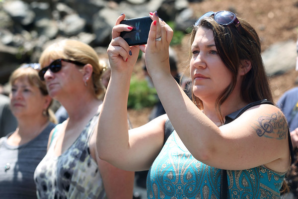 """HADLEY GREEN/Staff photo<br /> Jennifer Russo, a descant of Mary Eastey, takes a photo during the new Proctor's Ledge memorial dedication ceremony. """"We're blessed as descendants that somebody cared enough to do this,"""" says Russo of the new memorial. Mary Eastey was one of the 19 innocent people hanged in 1692 for the supposed crime of witchcraft. 7/18/17"""