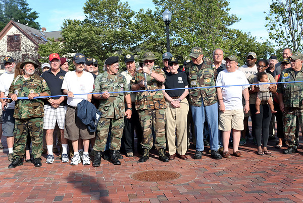 HADLEY GREEN/Staff photo<br /> Veterans commemorate the new Vietnam Veterans Memorial Plaza at One Ellis Square in downtown Beverly at a ribbon cutting ceremony. 7/28/17