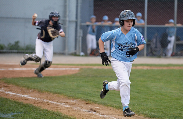 RYAN HUTTON/ Staff photo<br /> Peabody's Aidan Been runs it out to first base during the bottom of the fourth inning of Saturday night's Section 4 Little League championship against Gloucester at Wyoma Field.