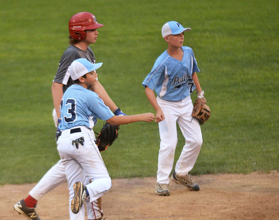 CARL RUSSO/Staff photo. SALEM NEWS: Peabody's Roberts Galvis makes the throw to first after making the out, North Andover's Andrew Perry, at second. Peabody Little League all-stars defeated North Andover National 6-2 in Section Four Little League sectional tournament. Thursday night.7/20/2017.