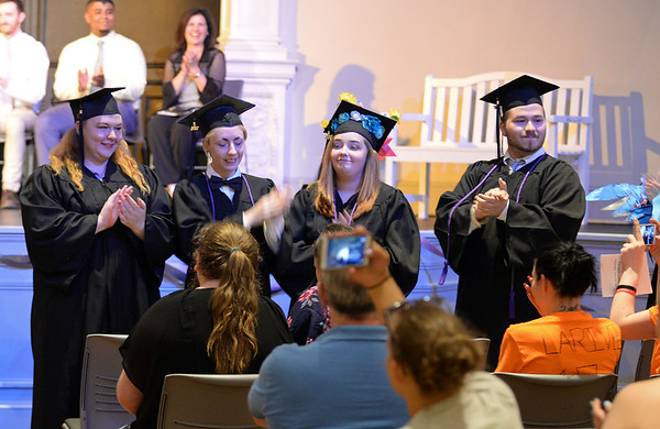 RYAN HUTTON/ Staff photo<br /> Members of the New Innovation School's Class of 2017 raise to give their friends and family a round of applause at the school's graduation ceremony at the Salem YMCA's Ames Hall on Thursday.
