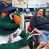KEN YUSZKUS/Staff photo. Red Sox mascot Wally the Green Monster surprised Cove Elementary School teacher Ellen Salley at her retirement send-off. Salley has been teaching second grade in Beverly for 35 years.   6/5/14.