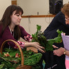 Stephanie Raymond, an Intern at Lahey Health, hands out a bunch of Swiss Chard to Peabody resident Marge Carresi, during the first of a new weekly farmers market held by the Peabody Council on Aging and Lahey Health at the Torigian Center on Friday afternoon. DAVID LE/Staff photo. 6/20/14.