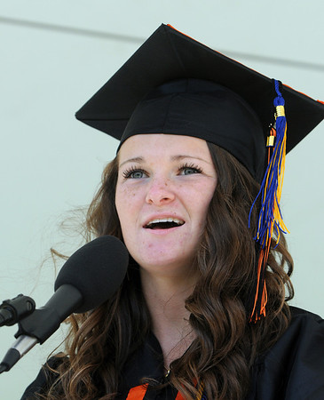 KEN YUSZKUS/Staff photo. Class president Diandra Crowley delivers the greetings speech during the Beverly High School graduation at Hurd Stadium .   6/1/14.