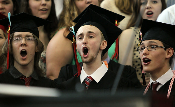"Marblehead High School senior chorus members Aidan Finn, Alec Glass, and Gwyn Higgins sing ""I Lived"" with the rest of the MHS Chorus during graduation on Sunday afternoon. DAVID LE/Staff photo. 6/8/14."