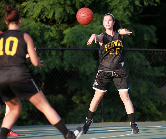 Bishop Fenwick rising junior Ellen Fantozzi makes a pass to teammate Lexi Rose on Monday evening. DAVID LE/Staff photo. 6/30/14.