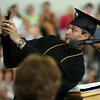 Marblehead High School Salutatorian Jacob Beck makes a funny face while taking a selfie with the Class of 2014 in the background during this Salutatory Address on Sunday afternoon. DAVID LE/Staff photo. 6/8/14.