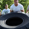 Danvers rising junior Marco LaGambina digs deep to flip over a tire as part of the Lineman Challenge at Masconomet Regional High School, a competition for local high school offensive and defensive linemen and run by Masco head football coach Jim Pugh. DAVID LE/Staff photo. 6/20/14.