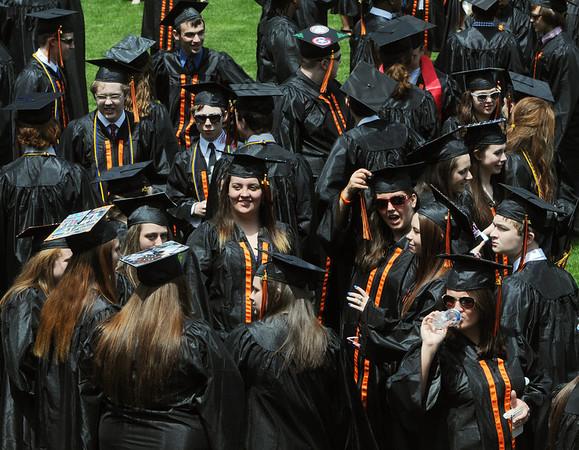 KEN YUSZKUS/Staff photo. Graduates assemble and mingle before the Beverly High School graduation.   6/1/14.