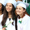 Salem Academy Charter School Nadia Tabbara and Brittnee Drafahl smile during a class photo prior to the start of graduation on Friday afternoon. DAVID LE/Staff photo. 4/13/14.