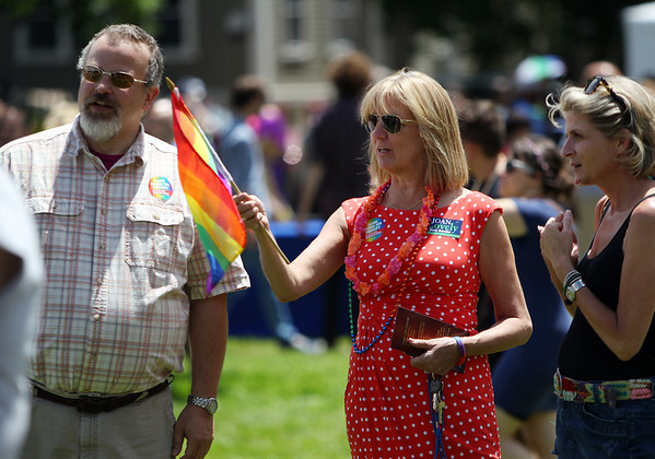 Ward 5 City Councilor Josh Turiel, left, talks with Senator Joan Lovely, center, and Paula Jacobson, of Boston, at the annual Gay Pride Parade festivities at Salem Common on Saturday afternoon. DAVID LE/Staff photo. 6/21/14.