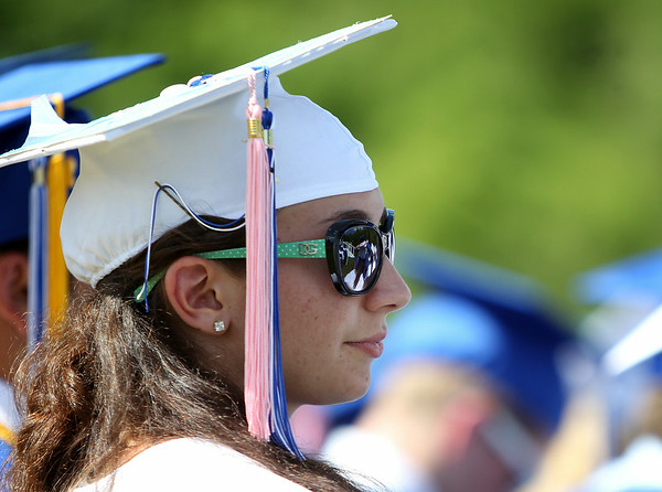 Danvers High School graduate Sarah Carey listens to speeches given by her classmates during graduation on Saturday afternoon. DAVID LE/Staff photo. 6/7/14.
