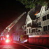 Marblehead Fire Department's Ladder 1 sits in front of the Eastern Yacht Club in Marblehead after a 3-alarm fire broke out early Friday morning. DAVID LE/Staff photo. 6/13/14