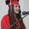 Marblehead High School senior class vice-president Alea Moscone announces the presentation of the class gifts during graduation on Sunday afternoon. DAVID LE/Staff photo. 6/8/14.