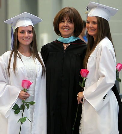 Danvers High School graduates Catherine McCartin, left, and Caitlin Tivnan, right, pose for a photo with Principal Susan Ambrozavitch, prior to the start of graduation on Saturday afternoon. DAVID LE/Staff photo. 6/7/14.
