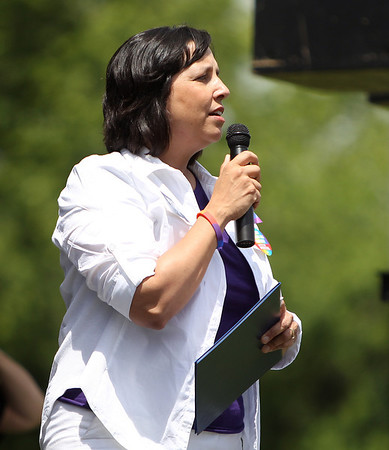 Salem Mayor Kim Driscoll thanks the large crowd gathered at Salem Common for coming out and supporting the annual Gay Pride Parade on Saturday afternoon. DAVID LE/Staff photo. 6/21/14.