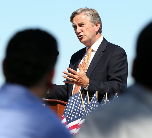 Congressman John Tierney gives congratulatory remarks to a group of new citizens during a Naturalization ceremony on the back lawn of the House of Seven Gables in Salem on Friday afternoon. DAVID LE/Staff photo. 6/27/14.