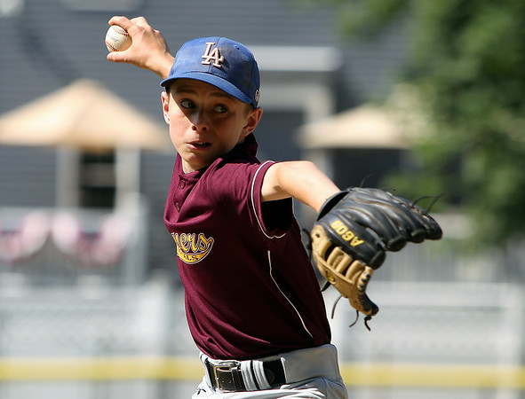 Danvers National All-Star Liam McKenna fires a pitch during practice at Tapley Field in Danvers on Thursday afternoon. DAVID LE/Staff photo. 6/19/14.