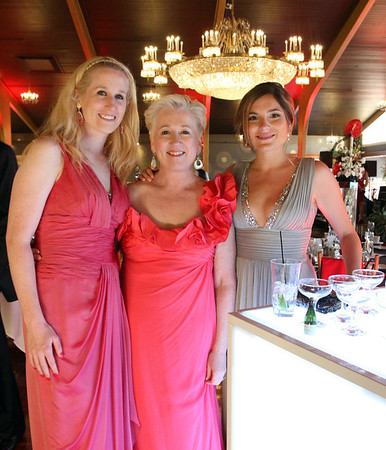 MARIA UMINSKI/SALEM NEWS Meghan Gould, Sheryl Gould and Sarah Gordon all of Danvers pose pose for a photo during the Danvers Family Festival kick-off event, Horray for Hollywood at the Danversport Yacht Club on Friday night.