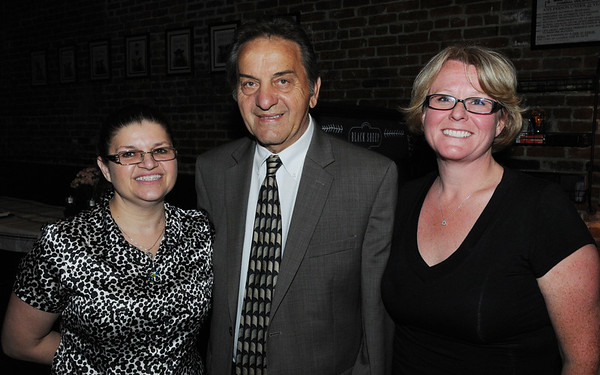 KEN YUSZKUS/Staff photo. From left, Lill Chalifour co-owner of the Black Sheep Pub & Grille, Ward 3 city councilor Jim Moutsoulas, and Zoe Hornsby of Advantage Payroll attend the Peabody Chamber of Commerce gathering at the newly opened Black Sheep Pub & Grille in Peabody.  6/2/14.
