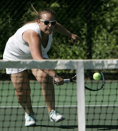 KEN YUSZKUS/Staff photo. Swampscott singles player Veronica Pyatigorskaya scoops up one at the Austin Prep at Swampscott girls tennis state tournament match.  6/2/14.