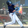 Hamilton-Wenham cleanup hitter Will Frain singles home a run in the bottom of the first inning against Danvers National in District 15 play on Monday evening. DAVID LE/Staff photo. 6/30/14.