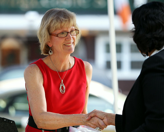 Sara Peller, representing the Red Cross, shakes hands with Mayor Kim Driscoll after giving a short speech and receiving a plaque of thanks from the City of Salem for the Red Cross's contributions in helping those affected by the Great Salem Fire of 1914. DAVID LE/Staff photo. 6/25/14.