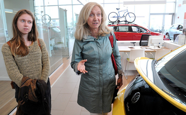 KEN YUSZKUS/Staff photo. Customers Claire Leggett, right, and her daughter Mimi, both of Manchester, talk about their experience while shopping at Kelly Volkswagen on Route 114 in Danvers.  6/13/14.