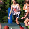 Masco's ________ carries the ball up court on Monday evening. DAVID LE/Staff photo. 6/30/14.