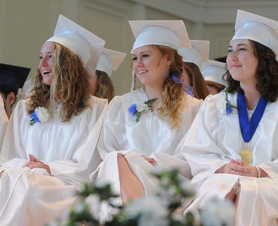 KEN YUSZKUS/Staff photo. Graduates share a laugh during the salutatorian's speech during the Hamilton-Wenham graduation at Gordon College Chapel.   6/1/14.