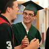 Essex Aggie graduate RJ Conroy, right, greets his friend Matt Slauter, left, with a hug and smile prior to the start of the final Commencement ceremony for the Essex Agricultural and Technical High School. Next year Essex Aggie and North Shore Technical High School will combine into one school. DAVID LE/Staff photo. 6/5/14.