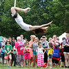 Hundreds of people gathered at Salem Common on Saturday afternoon and watch Rockport native Eileen Little, of Fight or Flight Theater perform a trapeze act during the annual Gay Pride Parade festivities. DAVID LE/Staff photo. 6/21/14.