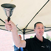 KEN YUSZKUS/Staff photo. Salem Police Chief Paul Tucker rings the opening bell on the opening day of the farmers market, now in its 6th season.    6/12/14.