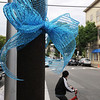 KEN YUSZKUS/Staff photo. A blue ribbon hangs on Pleasant Street at the corner of School Street in Marblehead.  6/9/14.