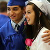 Danvers High School graduates Chris Nourai and Courtney Becker pose for a photo together as the Danver High School Class of 2014 gathered in the gymnasium prior to the start of graduation on Saturday afternoon. DAVID LE/Staff photo. 6/7/14.