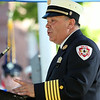 Salem Fire Department Chief David Cody gives some remarks about the Great Salem Fire of 1914 during a commemoration ceremony at Lafayette Park on Wednesday afternoon. DAVID LE/Staff photo. 6/25/14.