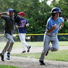 Danvers National Kevin Jordan, right, sprints for home while being chased down by teammate Ian Paskowski, left, during a rundown drill at Tapley Field in Danvers on Thursday afternoon. DAVID LE/Staff photo. 6/19/14.