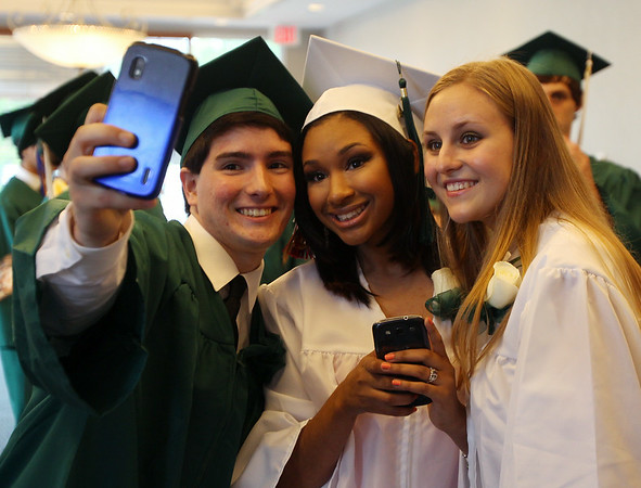 Salem Academy Charter School graduates David Ambrose, Erika Garcia, and Anna Novicheva, take a selfie prior to the start of graduation on Friday afternoon. DAVID LE/Staff photo. 4/13/14.