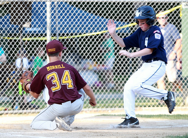 Danvers National pitcher Mike Morrill (34) prepares to tag out Hamilton-Wenham's Michael Ayers at the plate as Ayers tried to score on a wild pitch on Monday evening. DAVID LE/Staff photo. 6/30/14.
