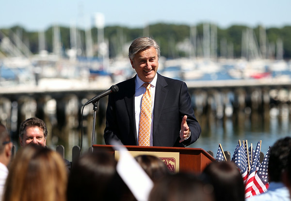 Congressman John Tierney congratulates a small group of new United States citizens during a Naturalization ceremony on the back lawn of the House of Seven Gables in Salem on Friday afternoon. DAVID LE/Staff photo. 6/27/14.