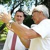 Tom Zellen, right, talks about the roof repairs on the Nathaniel Felton Sr. House with Peabody Mayor Ted Bettencourt on Thursday afternoon. DAVID LE/Staff photo. 6/19/14.
