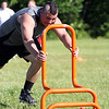 Danvers soon-to-be senior Logan Dunn pushes a weighted sled during a time challenge at the Lineman Challenge at Masconomet Regional High School, a competition for local high school offensive and defensive linemen and run by Masco head football coach Jim Pugh. DAVID LE/Staff photo. 6/20/14.