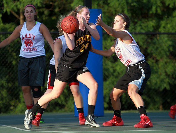 Bishop Fenwick rising junior captain Colleen Corcoran (24) makes a pass around a Masco defender on Monday evening. DAVID LE/Staff photo. 6/30/14.