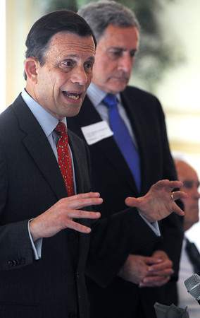 KEN YUSZKUS/Staff photo. Steve Grossman speaks at The North Shore Chamber of Commerce's breakfast held at the Hawthorne Hotel. Chairman William Tinti listens while standing at his side. 6/11/14.